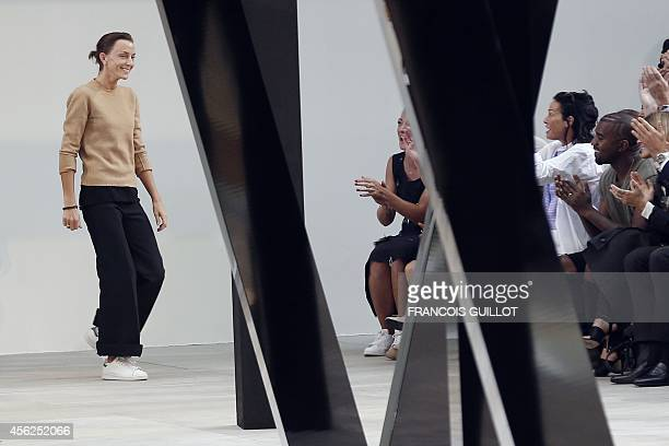 British fashion designer Phoebe Philo acknowledges the audience at the end of the Celine 2015 Spring/Summer readytowear collection fashion show on...