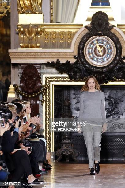 British fashion designer Stella McCartney acknowledges the public at the end of her 2014/2015 Autumn/Winter readytowear collection fashion show on...