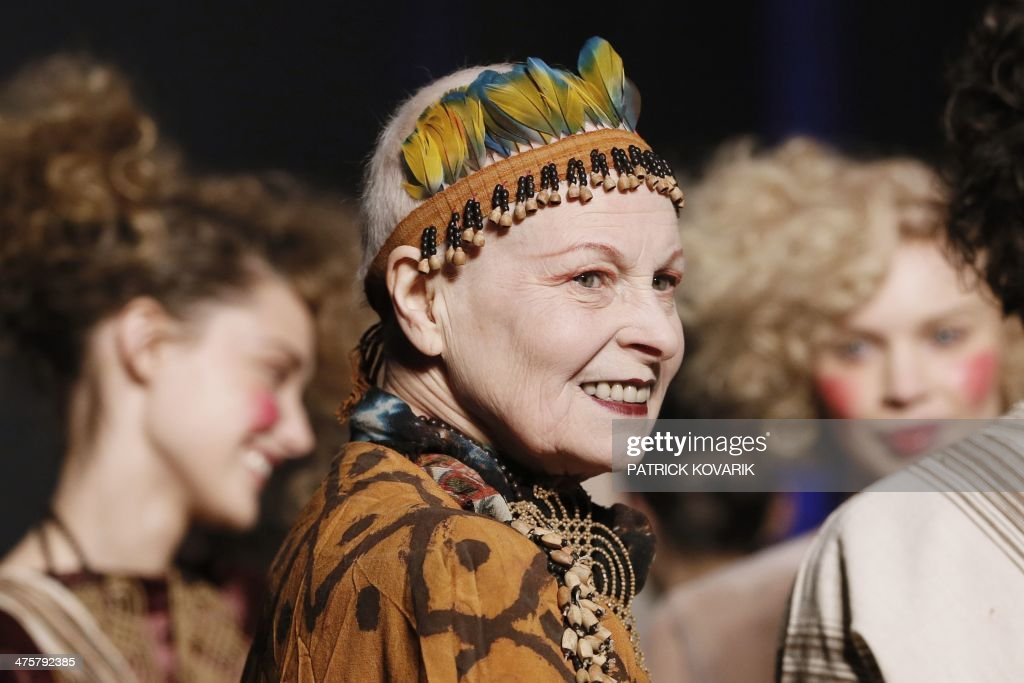 British fashion designer Vivienne Westwood acknowledges the public at the end of her 2014/2015 Autumn/Winter readytowear collection fashion show on...