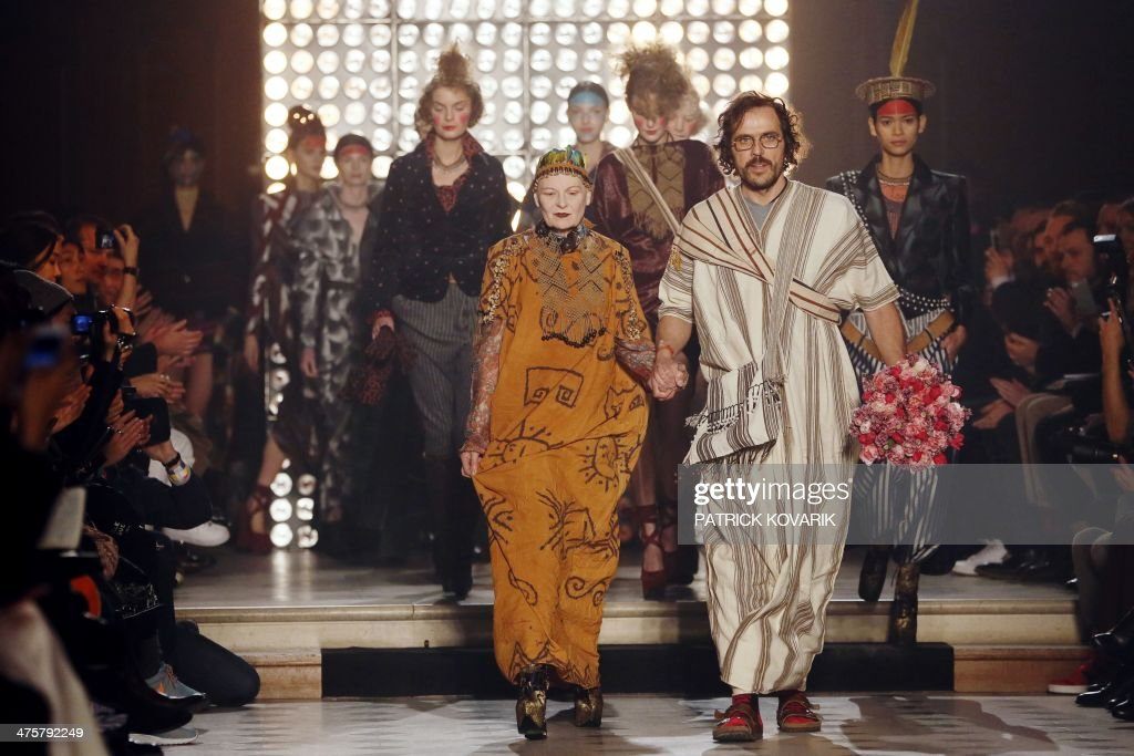 British fashion designer Vivienne Westwood acknowledges the public with her husband Andreas Kronthaler a the end of her 2014/2015 Autumn/Winter...