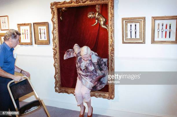 British fashion designer Vivienne Westwood posing as an oil painting and jumping out at the launch of a 'Swatch' watch to accompany clothes designed...