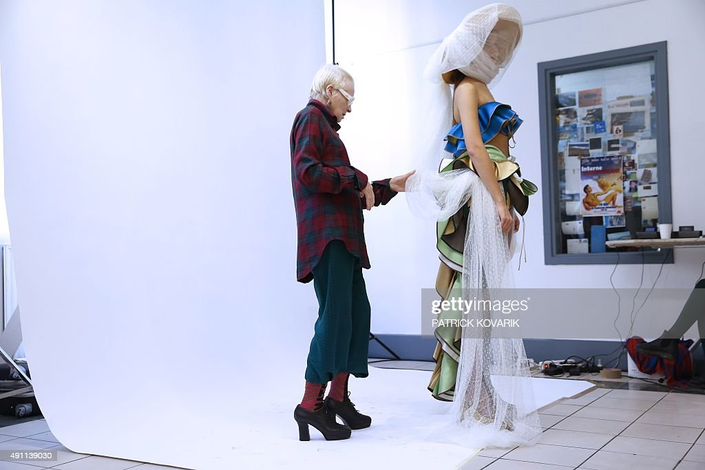 British fashion designer Vivienne Westwood prepares a model before her 2016 Spring/Summer readytowear collection fashion show on October 3 2015 in...