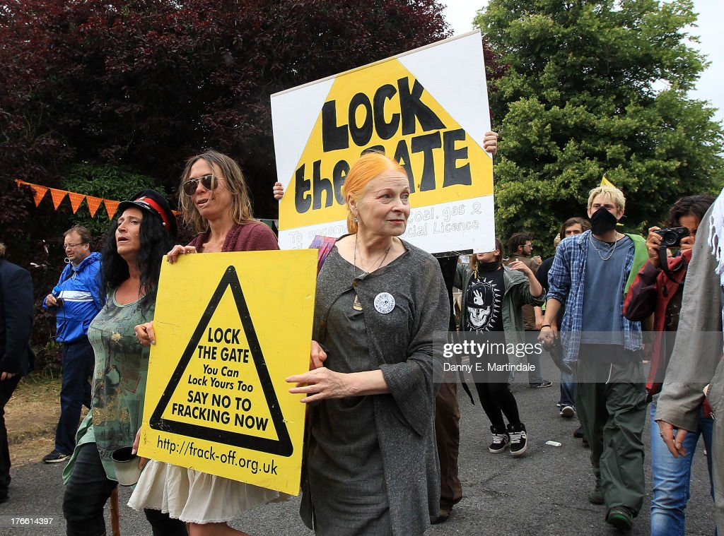 British Fashion designer Vivienne Westwood walks with protesters as she arrives at the anti-fracking camp on August 16, 2013 in Balcombe, United Kingdom. More than 1,000 protesters have started arriving at the small Sussex village of Balcombe for a five-day anti-fracking camp. Energy firm Cuadrilla is scaling back work at the exploration site in West Sussex after advice from the police.