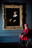 British fashion designer Zandra Rhodes poses for photographers as she recreates Rembrandt's 'Portrait of Catrina Hooghsaet' in front of the original...