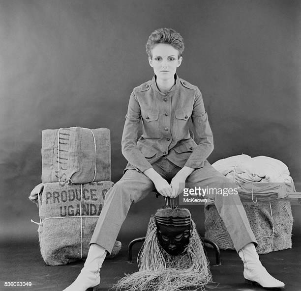British fashion model Grace Coddington shows a safari pant suit and boots 1967