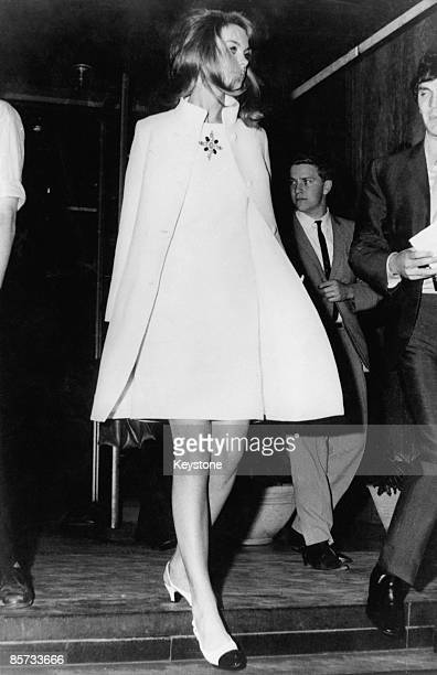 British fashion model Jean Shrimpton in a matching white kneelength dress and coat Australia 1965