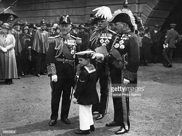 British Field Marshal Sir Douglas Haig British Admiral Lord John Jellicoe and British politician Sir West Ridgeway attend the reopening ceremony at...