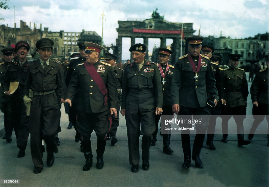 British Field Marshall Bernard Montgomery (1887 - 1976, centre, right) leaves the Brandenburg Gate after a ceremony to decorate Soviet Generals, Berlin, 12th July 1945. With him are Marshals of the Soviet Union Georgy Zhukov (1896 - 1974, centre, left), Vasily Sokolovsky (1897 � 1968, centre, right, background) and Konstantin Rokossovsky (1896 � 1968, centre, right, foreground).