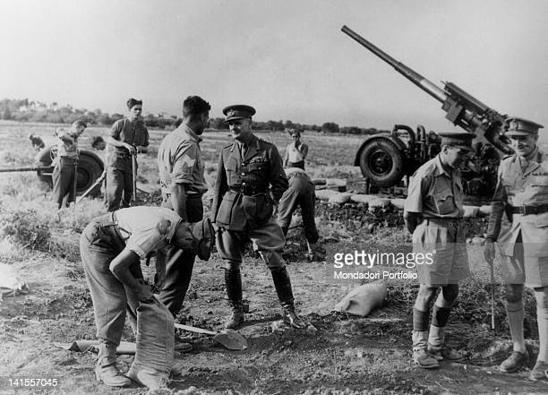 British fieldmarshal Archibald Wavell and other officers inspecting the troops preparing an airfield with antiaircraft emplacements Greece October...