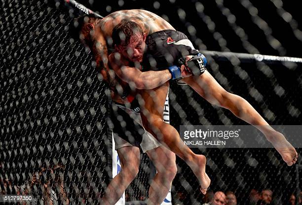 British fighter Brad Pickett lifts US fighter Francisco Rivera during their Bantamweight bout at the Ultimate Fighting Championship Fight Night event...