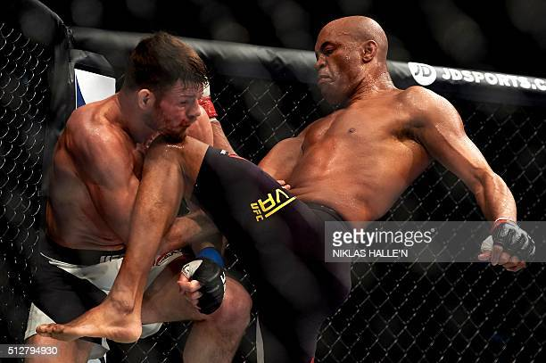 British fighter Michael Bisping competes with Anderson Silva of Brazil during their middleweight bout at the Ultimate Fighting Championship Fight...
