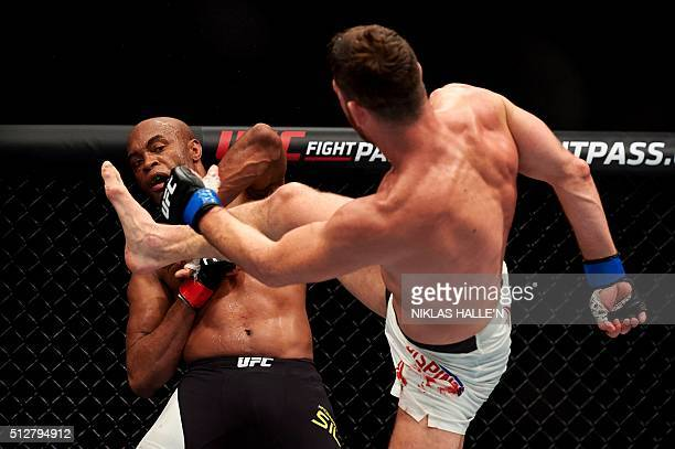 British fighter Michael Bisping kicks out during his fight with Anderson Silva of Brazil in their middleweight bout at the Ultimate Fighting...