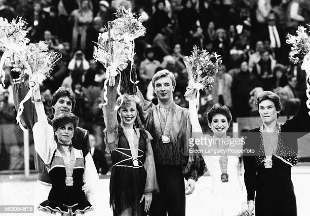 British figure skaters Jayne Torvill and Christopher Dean celebrating on the podium after winning the gold medal for ice dancing at the 1984 Winter...