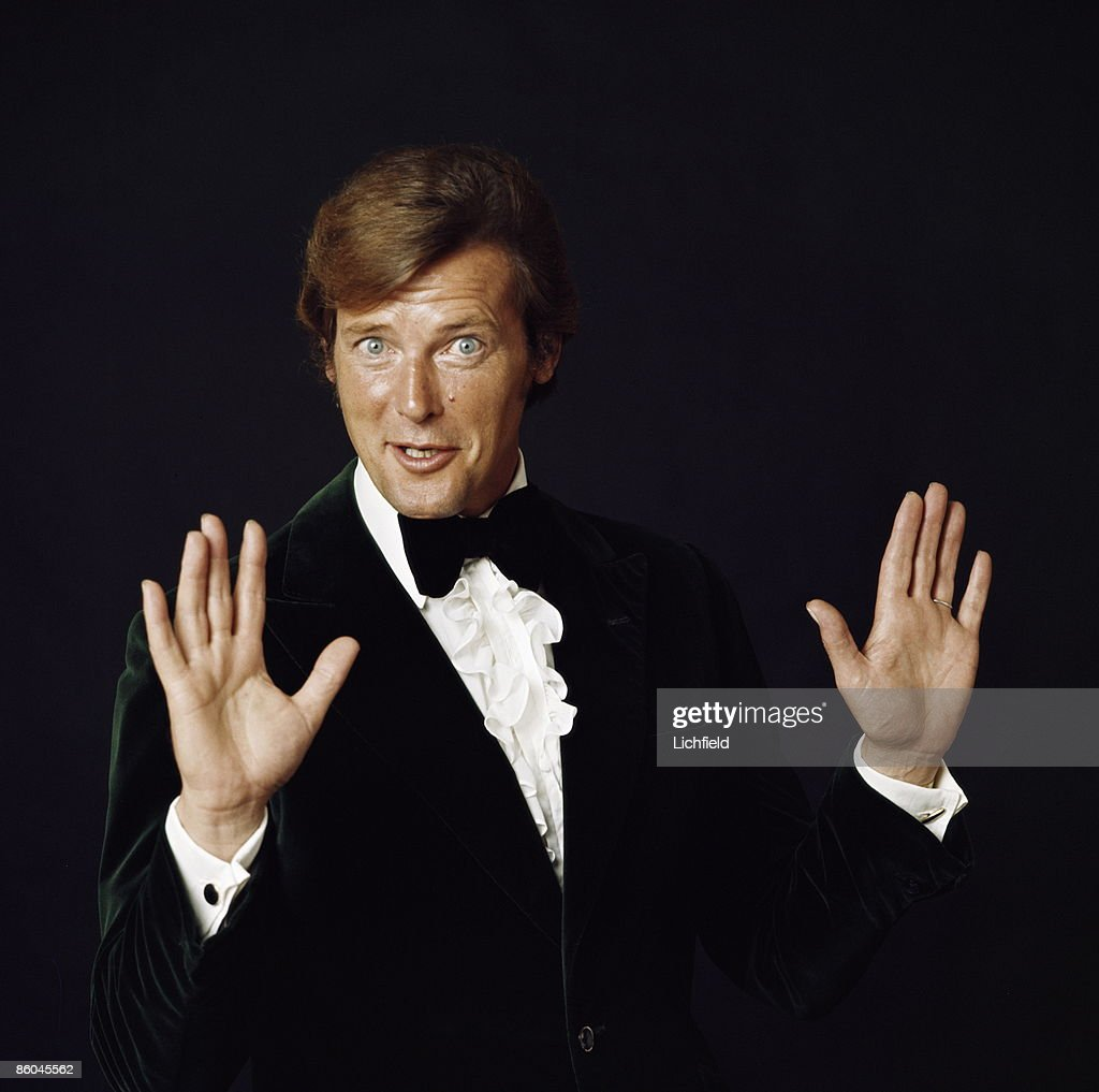 British film actor <a gi-track='captionPersonalityLinkClicked' href=/galleries/search?phrase=Roger+Moore+-+Actor&family=editorial&specificpeople=160468 ng-click='$event.stopPropagation()'>Roger Moore</a>. Best known for his role as Simon Templar in The Saint and as James Bond, which he played in seven movies, photographed in the Studio on 8th July 1971. (Photo by Lichfield/Getty Images).