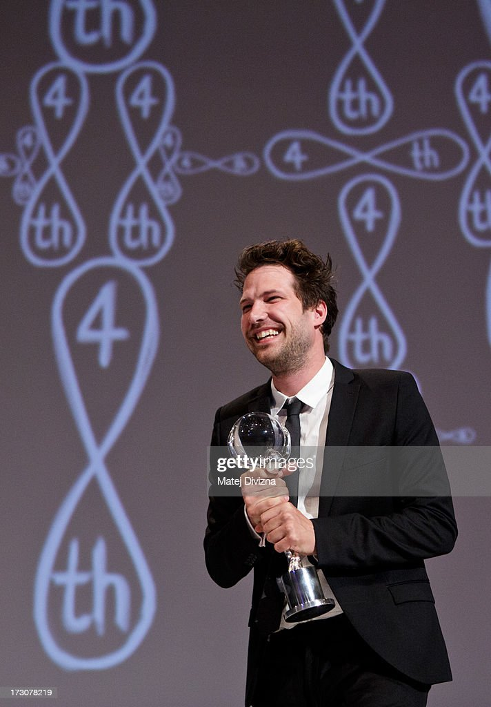 British film director Emil Langballe holds the Crystal Globe, Best Documentary Film Under 30 minutes Long at the closing ceremony of the 48th Karlovy Vary International Film Festival (KVIFF) on July 06, 2013 in Karlovy Vary, Czech Republic.