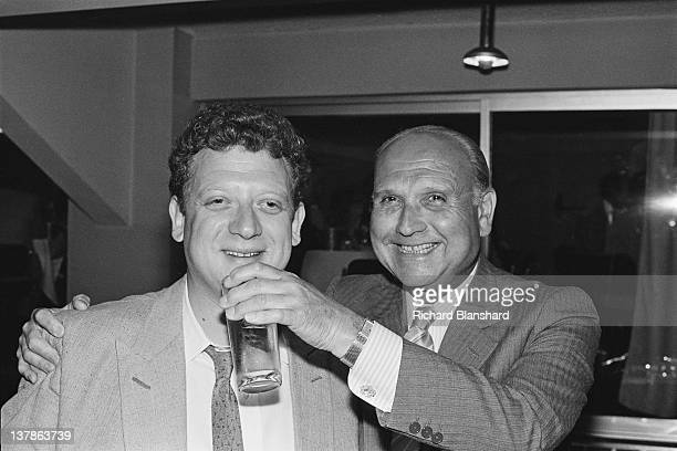 British film director Gerald Thomas with his nephew producer Jeremy Thomas at the Cannes Film Festival France May 1984