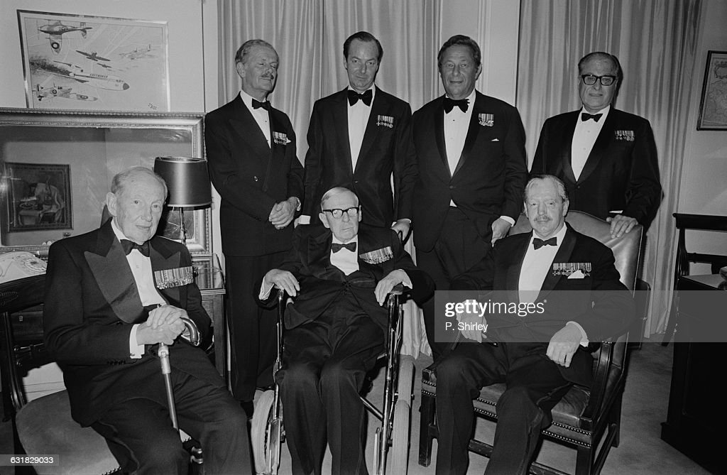 British film director Guy Hamilton (1922 - 2016, back row, second from left) with senior veterans of the Battle Of Britain, as well as the co-producer of his war epic 'Battle Of Britain', S. Benjamin Fisz (1922 - 1989) and historian Robert Wright (1906 - 1992), 16th September 1969. Back, left to right: Air Commodore Donald Macdonell (1913 - 1999), Hamilton, Fisz and Wright. Front, left to right: Air Chief Marshal Sir Douglas Evill (1892 - 1971), Air Chief Marshal Hugh Dowding (1882 - 1970) and fighter pilot Group Captain Tom Gleave (1908 - 1993). (Photo by P. Shirley/Daily Express/Hulton Archive/Getty Images