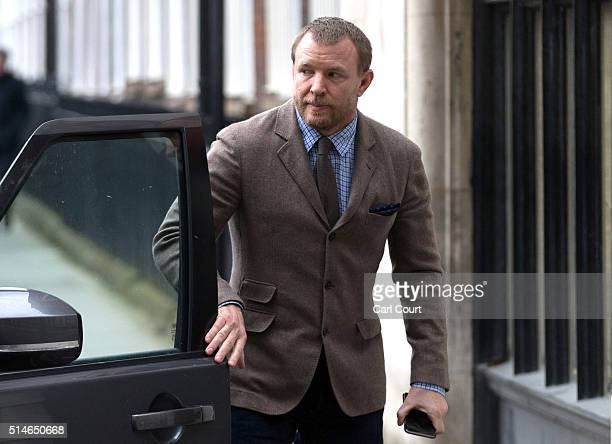 British film director Guy Ritchie arrives at the Royal Courts of Justice Strand on March 10 2016 in London England Mr Ritchie is currently engaged in...
