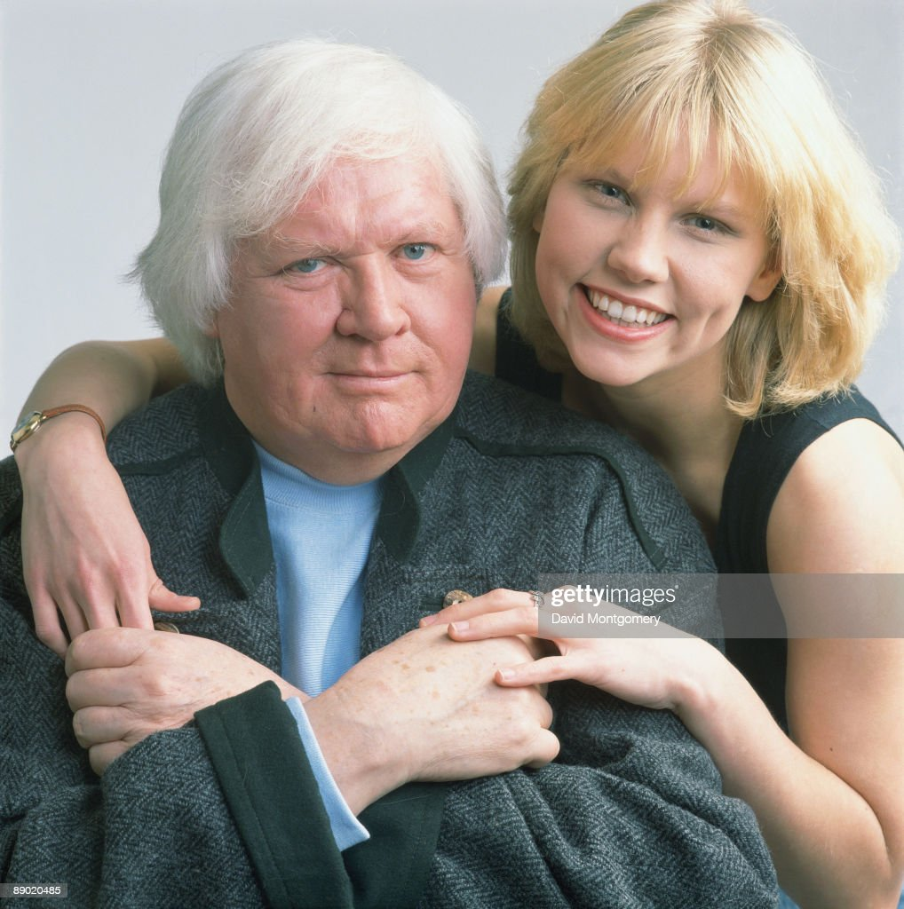 British film director Ken Russell with actress Sammi Davis, February 1989. The two worked together on 'The Lair of the White Worm' (1988) and are now collaborating on the D. H. Lawrence adaptation 'The Rainbow' (1989).