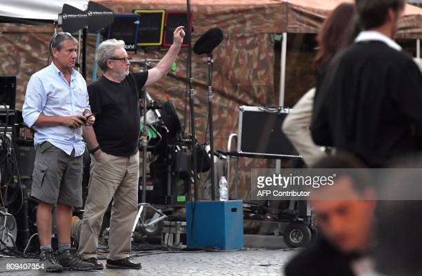 British film director Ridley Scott gestures as he gives indications on the set of his new movie 'All the money in the world' at Piazza Navona in...