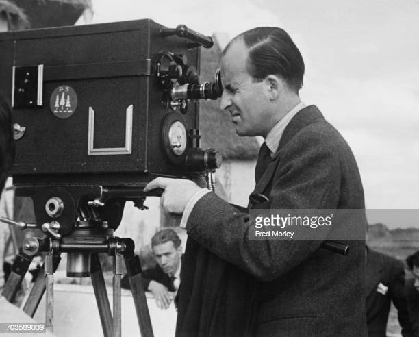 British filmmaker Frank Launder checks a camera angle during filming at Pinewood Studios Buckinghamshire 23rd September 1946