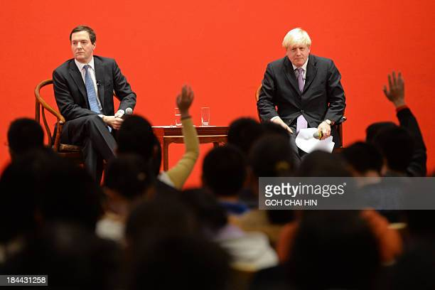 British Finance Minister George Osborne and London's Mayor Boris Johnson take questions from students at Peking University in Beijing on October 14...