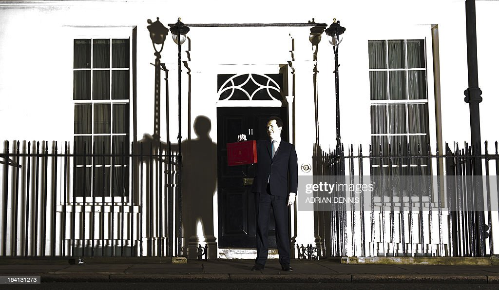 British Finance Minister George Osborne poses for pictures outside 11 Downing Street in London, on March 20, 2013, as he prepares to unveil the governments annual budget to parliament. Osborne was Wednesday set to stick firmly to the government's controversial austerity plan when he presents his latest annual budget to parliament despite a promise to spend on infrastructure, as Britain sails close to another recession.