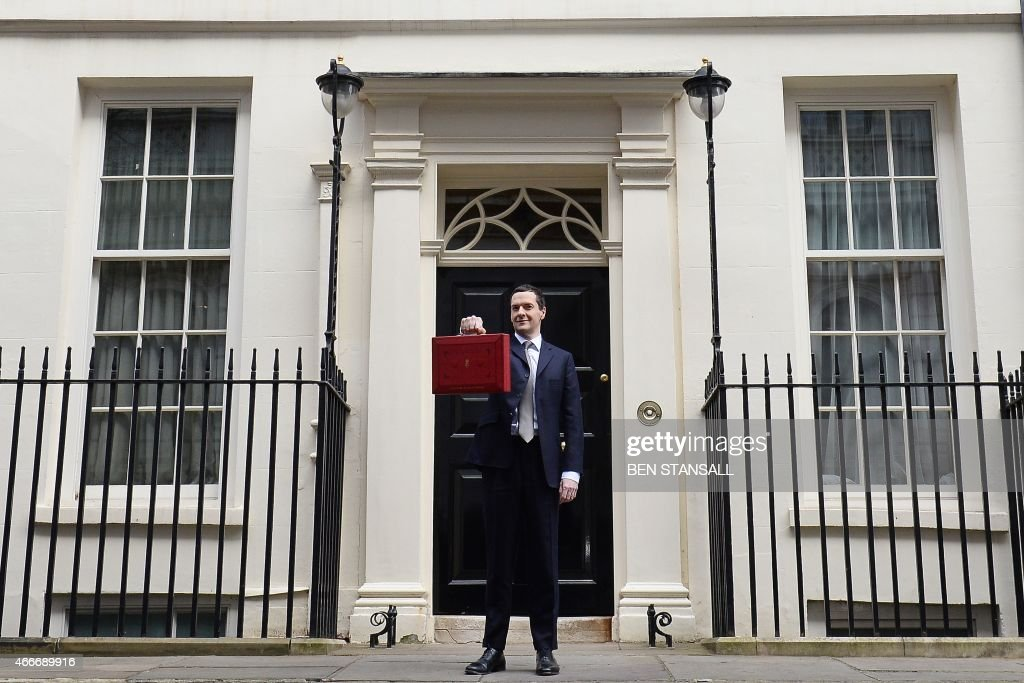 British Finance Minister George Osborne poses for pictures with the Budget Box as he leaves 11 Downing Street in London on March 18 before presenting...