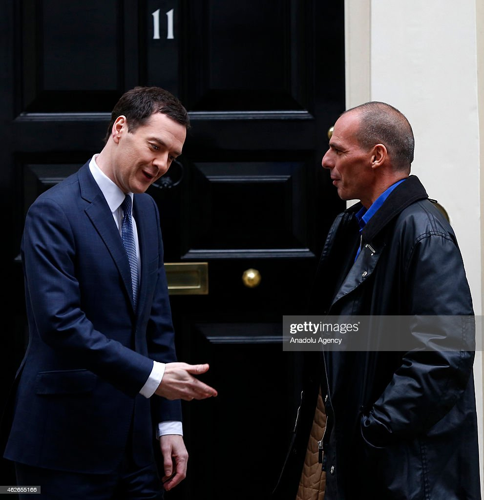 British Finance Minister George Osborne (L) welcomes Greece's new Finance Minister Yanis Varoufakis (R) outside number 11 Downing Street in central London on February 2, 2015.