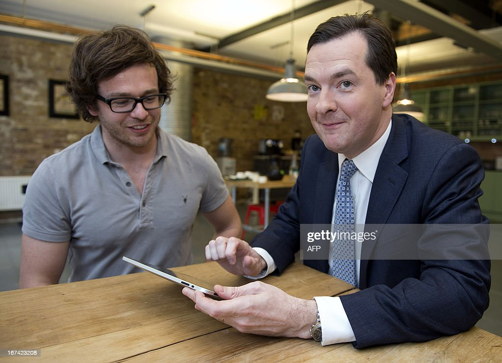 British finance minister George Osbornes (R) plays a game on a tablet as he sits next to Howard Kingston, CEO and co-founder of Future Ad Labs, during a visit to Unruly Media, an East London tech company, in London on April 25, 2013. Britain avoided falling into a third recession since the 2008 global financial crisis after its economy grew by a better-than-expected 0.3 percent in the first quarter compared with the final three months of last year, official data showed.