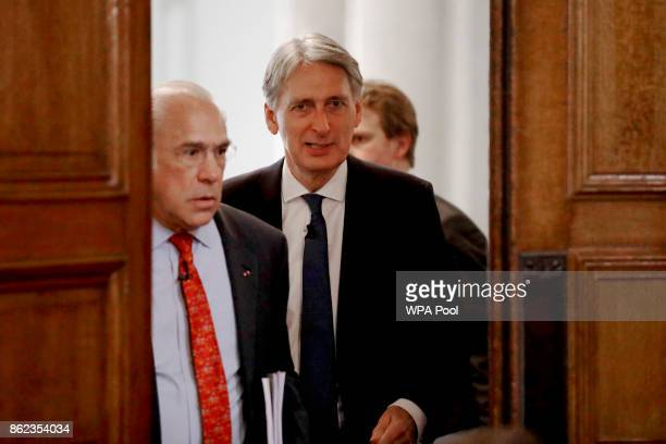 British Finance Minister Philip Hammond arrives to introduce the SecretaryGeneral of the Organisation for Economic Cooperation and Development Angel...
