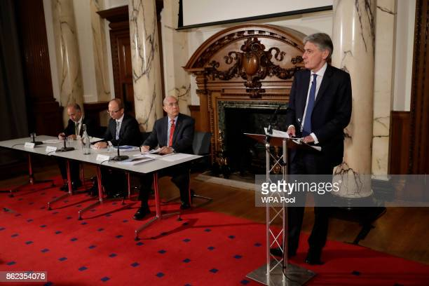British Finance Minister Philip Hammond introduces the SecretaryGeneral of the Organisation for Economic Cooperation and Development Angel Gurria...