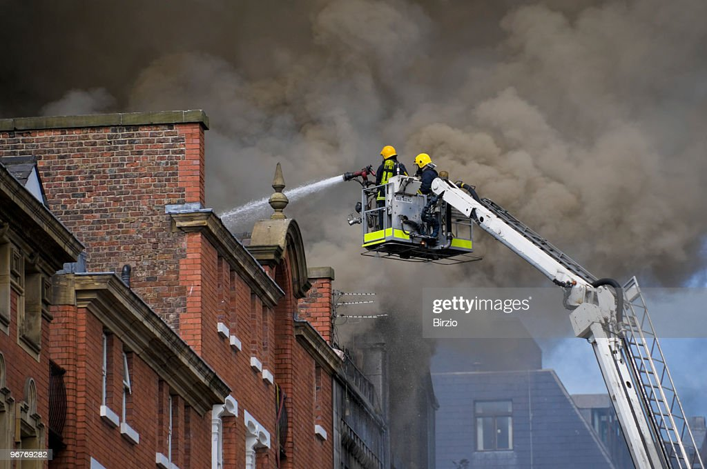 British Firemen in Action (close) : Stock Photo