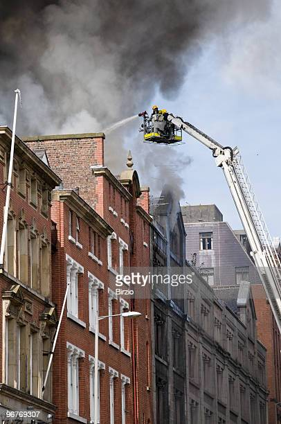 British Firemen in Action with the Hydrant