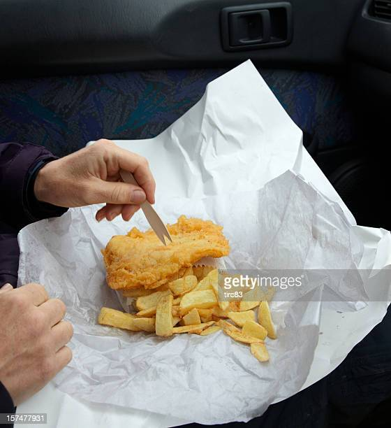 British fish and chips in paper hands