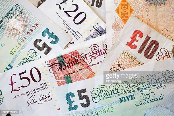 British five 20 and 50 pound banknotes sit in this arranged photograph in London UK on Tuesday Feb 9 2016 The pound has been falling versus the...