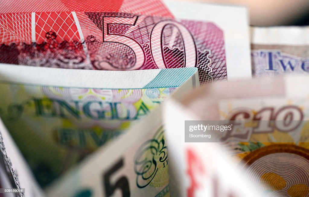 British five, 10, 20 and 50 pound banknotes stand in this arranged photograph in London, U.K., on Tuesday, Feb. 9, 2016. The pound has been falling versus the dollar since the middle of 2015 and accelerated its slide this year, reaching an almost seven-year low of $1.4080 on Jan. 21. Photographer: Chris Ratcliffe/Bloomberg via Getty Images