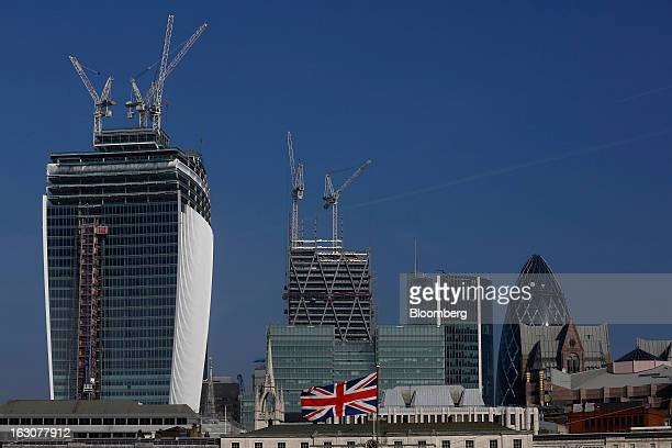 A British flag flies in front of the construction site of 20 Fenchurch Street or the 'WalkieTalkie' building left the Leadenhall Building also known...