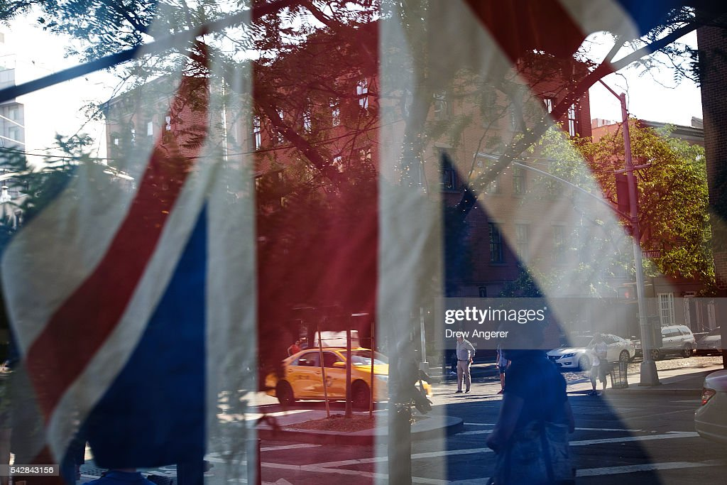 A British flag hangs in the window of Myers of Keswick, a British grocery store, June 24, 2016 in New York City. British citizens voted in a referendum (also known as the Brexit) to leave the European Union which has caused uncertainty across the world.