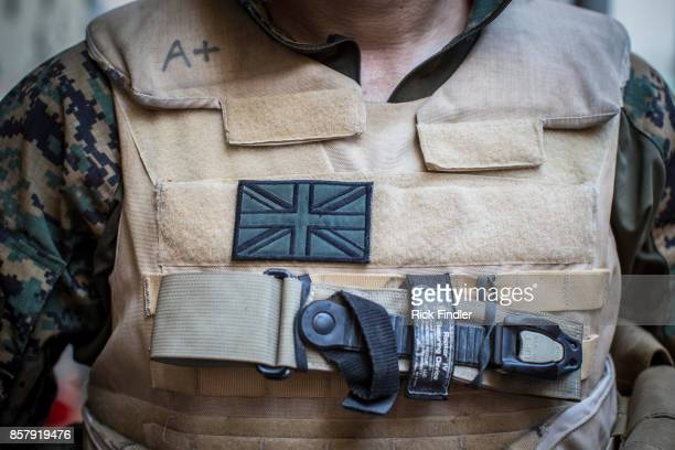 British flag is stuck to foreign volunteer fighter 'Macer Gifford's flakjacket on August 19 2017 in Raqqa The MFS are a group of Assyrian Christians...
