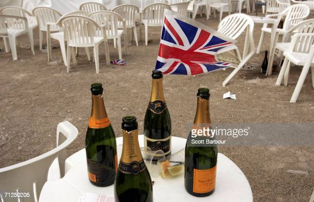 British flag lies in an empty champagne bottle after the first day of Royal Ascot at the Ascot Racecourse on June 20 2006 in Ascot England The event...