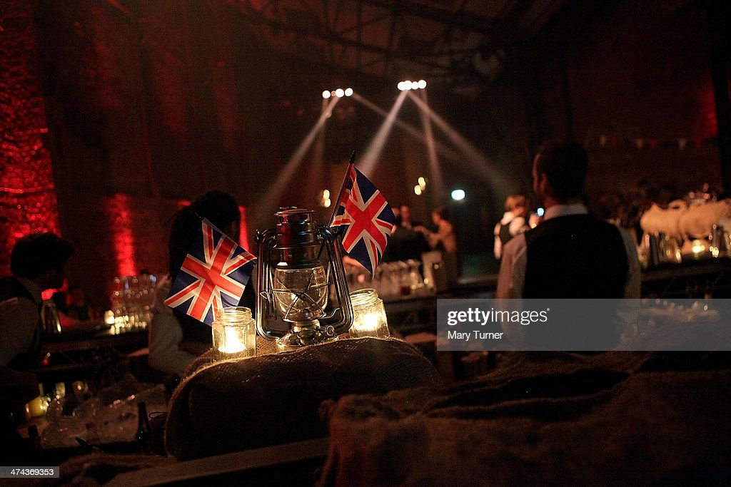 British flags and retro-style lamps create a nostalic atmosphere at The Blitz Party on February 22, 2014 in London, England. Deep in an East End bunker hundreds of vintage enthusiasts partied like it was 1940 in a range of vintage costumes, dancing to Swing and Jazz music while drinking themed cocktails, as they embraced the glamour of and nostalgia for the era.
