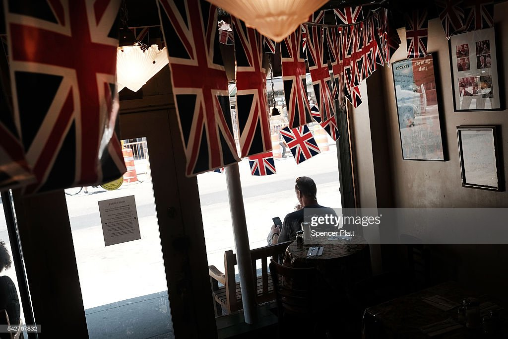 British flags hang from the ceiling of the popular British restaurant and grocery Tea & Sympathy in Manhattan on June 24, 2016 in New York City. The world was shocked on Friday morning to learn the Britain had vote to leave the European Union.