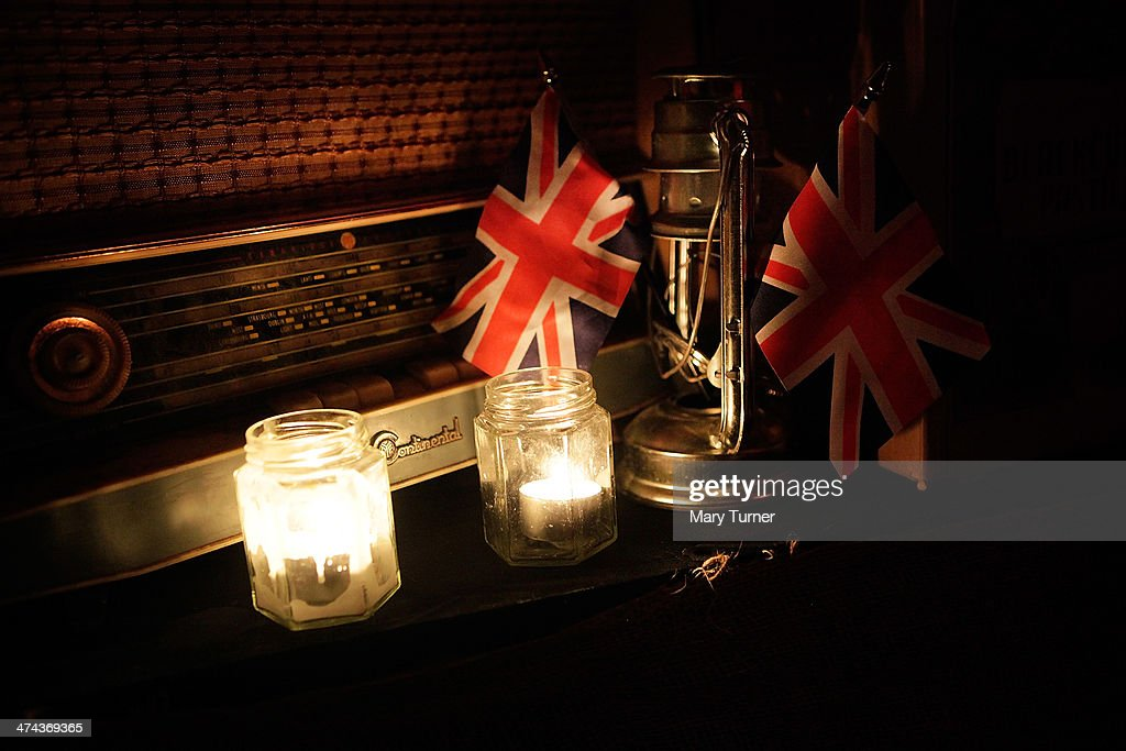British flags, retro-style lamps and wireless players create a nostalic atmosphere at The Blitz Party on February 22, 2014 in London, England. Deep in an East End bunker hundreds of vintage enthusiasts partied like it was 1940 in a range of 1940s costumes. They danced to Swing and Jazz music of the era while drinking themed cocktails, as they embraced the glamour of and popular nostalgia for the era.