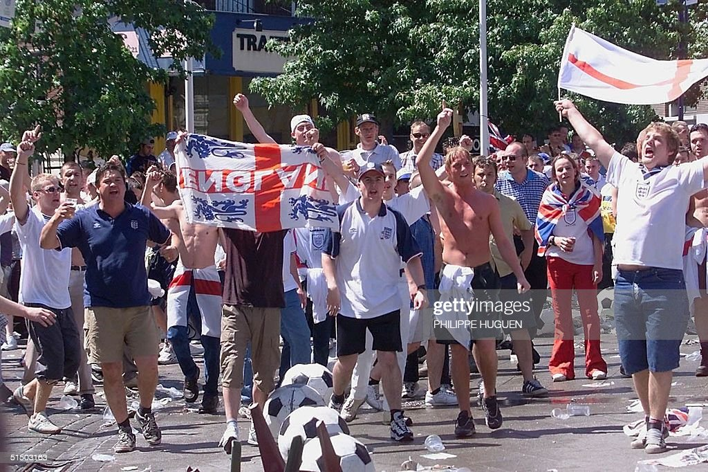 British football fans shout at policemen17 June 2000 a few hours before the Euro 2000 first round match between England and Germany in Charleroi...