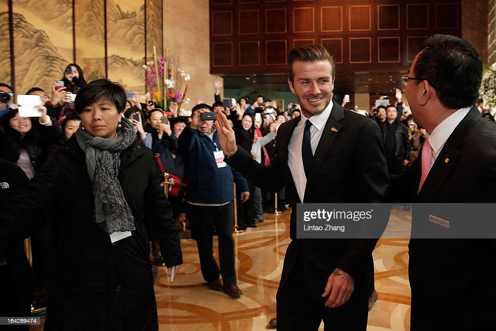 British football player <a gi-track='captionPersonalityLinkClicked' href=/galleries/search?phrase=David+Beckham&family=editorial&specificpeople=158480 ng-click='$event.stopPropagation()'>David Beckham</a> arrives at his hotel before a visit of the Qingdao Jonoon Football Club at Qingdao Shandong Province on March 22, 2013 in Qingdao, China. <a gi-track='captionPersonalityLinkClicked' href=/galleries/search?phrase=David+Beckham&family=editorial&specificpeople=158480 ng-click='$event.stopPropagation()'>David Beckham</a> is on a five-day visit to China at the invitation of the China Football Association as China's first international ambassador.