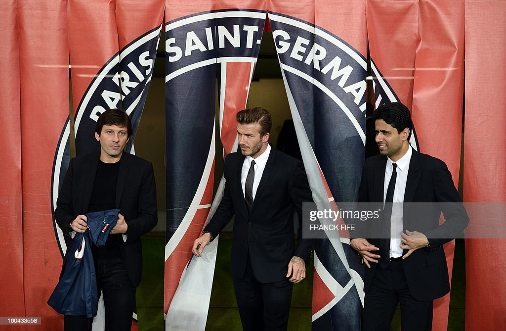 British football player David Beckham (C) arrives to pose with his new jersey flanked by PSG sports director Leonardo (L) and PSG Qatari president Nasser Al-Khelaifi after a press conference on January 31, 2013 at the Parc des Princes stadium in Paris. Beckham signed a five-month deal with the French Ligue 1 football club Paris Saint Germain until the end of June.