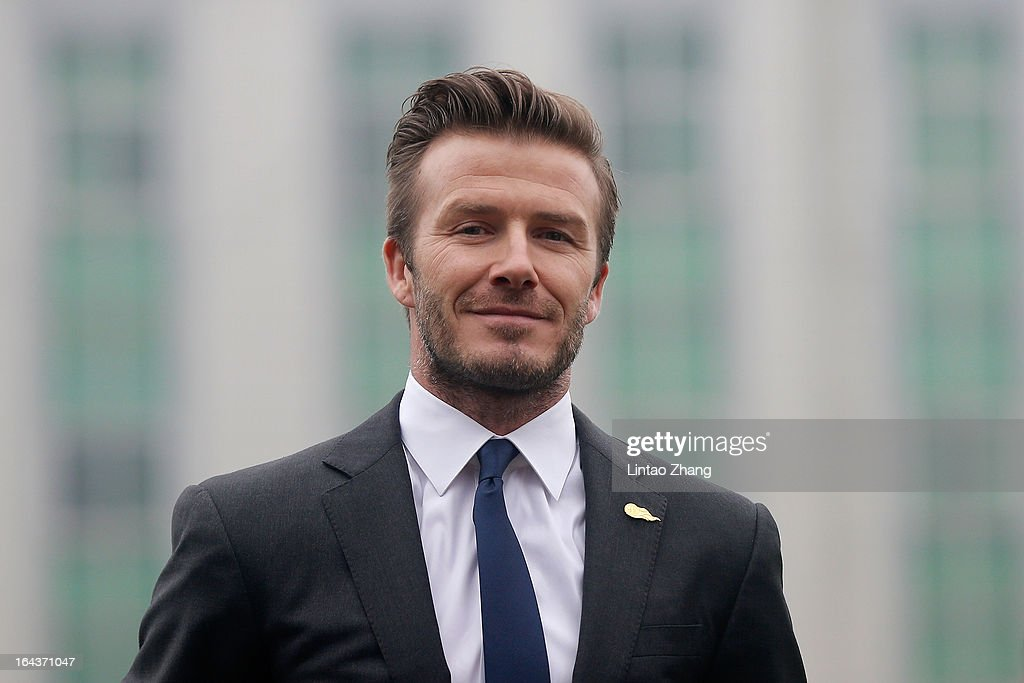 British football player David Beckham attends a meeting with the Youth Football Team at Hankou Literary and Sports Center on March 23, 2013 in Wuhan, China. David Beckham is on a five-day visit to China at the invitation of the China Football Association as China's first international ambassador.