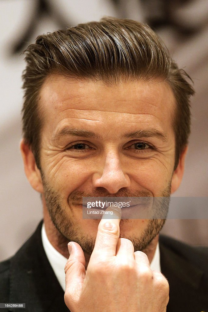 British football player <a gi-track='captionPersonalityLinkClicked' href=/galleries/search?phrase=David+Beckham&family=editorial&specificpeople=158480 ng-click='$event.stopPropagation()'>David Beckham</a> attends a press conference titled 'Ambassador for the Youth Football Programme in China and the Chinese Super League' at Qingdao Shandong Province on March 22, 2013 in Qingdao, China. <a gi-track='captionPersonalityLinkClicked' href=/galleries/search?phrase=David+Beckham&family=editorial&specificpeople=158480 ng-click='$event.stopPropagation()'>David Beckham</a> is on a five-day visit to China at the invitation of the China Football Association as China's first international ambassador.