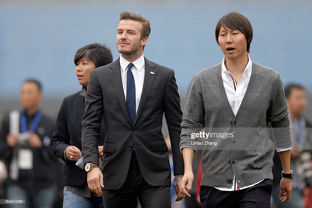 British football player David Beckham (L) attends meeting with the Youth Football Team at Hankou Literary and Sports Centeron March 23, 2013 in Wuhan, China. David Beckham is on a five-day visit to China at the invitation of the China Football Association as China's first international ambassador.